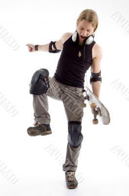 angered man beating something with his leg