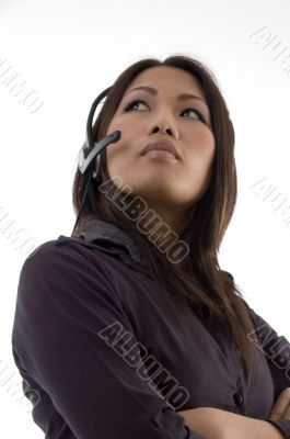 female with earphone and looking upward