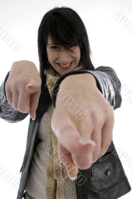 cheerful woman pointing towards camera