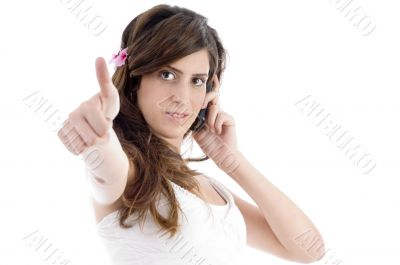 woman with cell phone showing approval sign