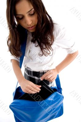 young student searching in her school bag