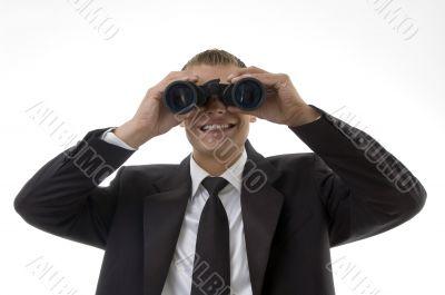 young accountant viewing through binoculars
