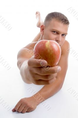 laying fit guy showing apple