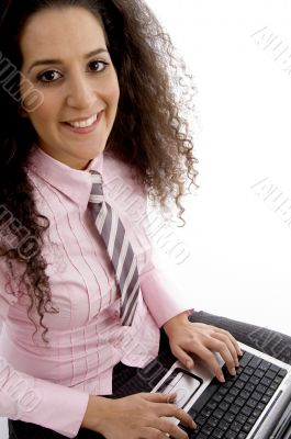 beautiful young businesswoman working on laptop