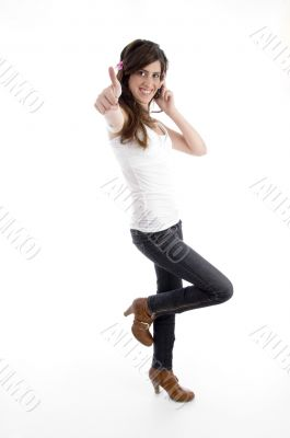 standing woman with cell phone wishing good luck
