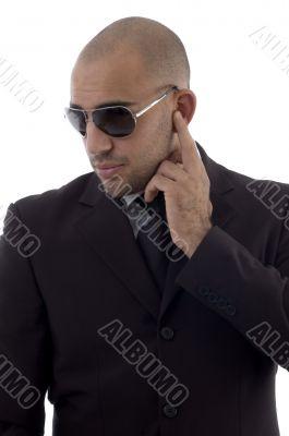 young accountant posing wearing sunglasses