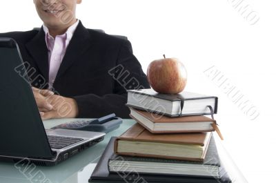 businessman with apple and books