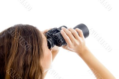 female watching through binocular