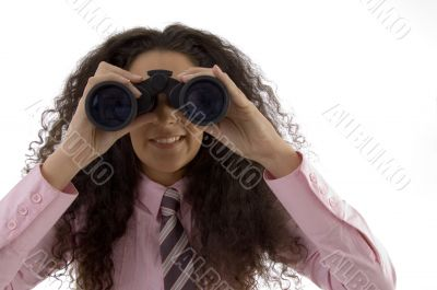 young corporate woman viewing through binoculars