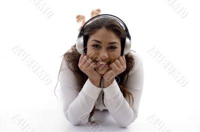 young female lying and enjoying music