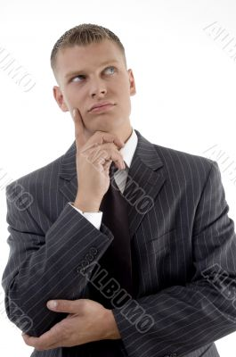 thinking businessman looking upward