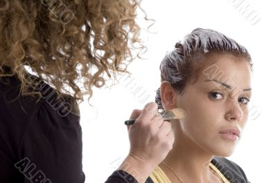 beautician doing make up of woman