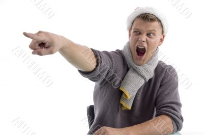 shouting male with christmas hat pointing aside