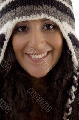 close up of beautiful woman wearing cap