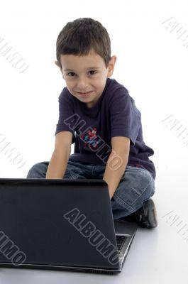 little intelligent boy doing work on laptop