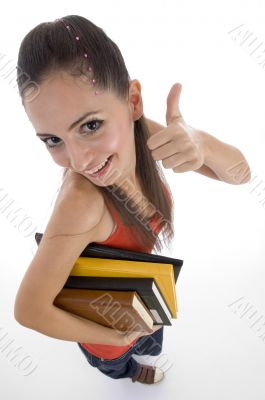 high angle view of student showing good luck sign