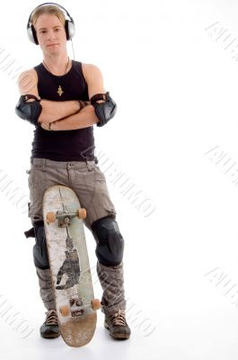 handsome guy posing with skateboard