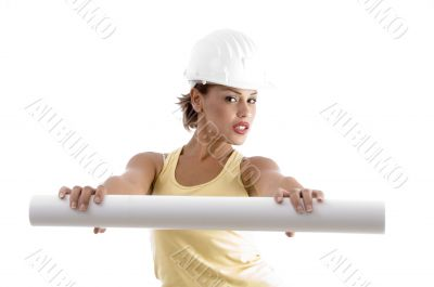 young woman with architect helmet and blue prints