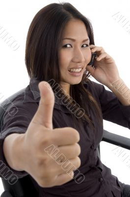 woman showing thumbs up while talking