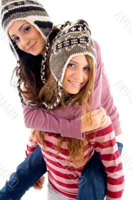 young girl giving piggyback to her friend