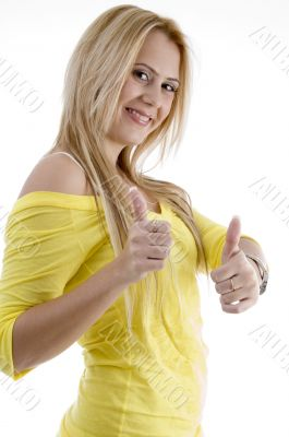 smiling woman showing good luck sign