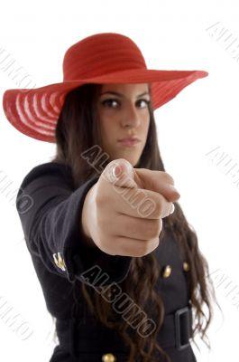 beautiful young female wearing hat pointing