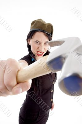 beautiful young woman striking with hammer