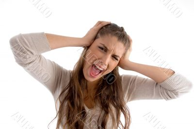 woman screaming and holding her head