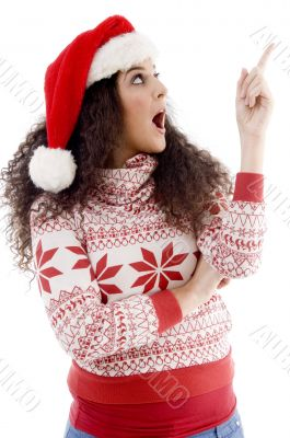 young female with christmas hat indicating upward