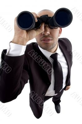 handsome young lawyer looking through binoculars