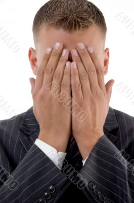 shy businessman hiding his face