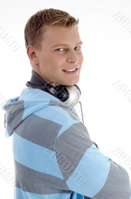 american man holding headphones around his neck