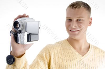 portrait of blonde man with handy cam