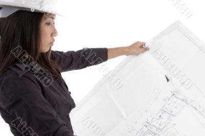 female architect looking at blueprints