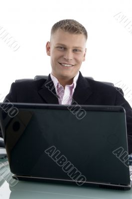 smiling young businessman with laptop