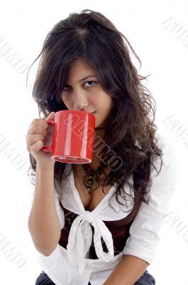 sexy teenager posing with coffee mug