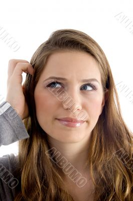 female scratching her head