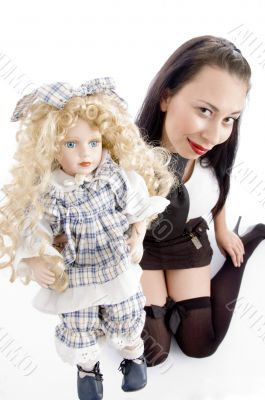 gorgeous woman playing with her cute doll