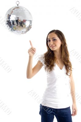 beautiful female pointing at mirror ball