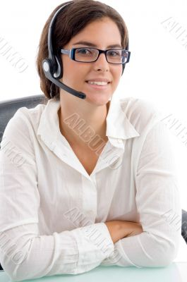 woman with headset and folded hands