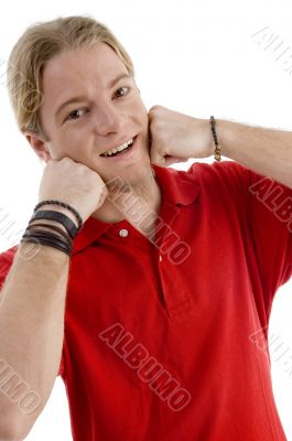 young american male posing with his hands on chin