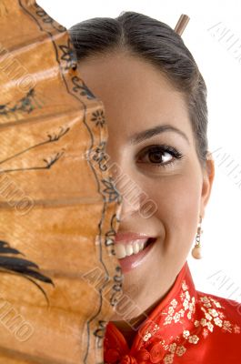 smiling face of female covered with umbrella