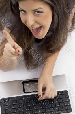 cheerful female busy with laptop