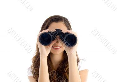 smiling female watching through binocular