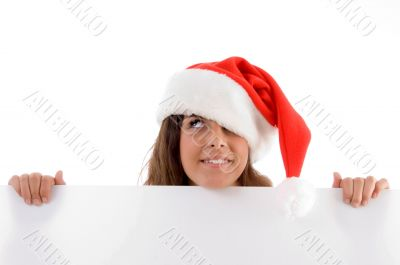 female wearing christmas hat and holding placard