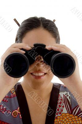 woman watching through binocular
