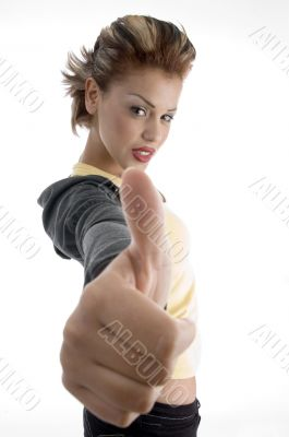 glamorous woman showing good luck sign