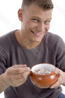 portrait of smiling male going to eat cornflakes