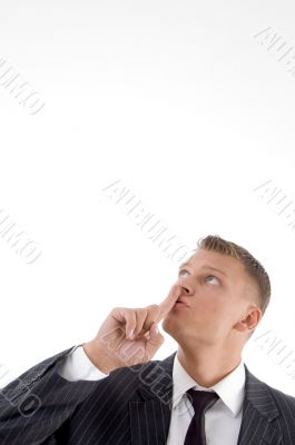 portrait of businessman asking to keep silent
