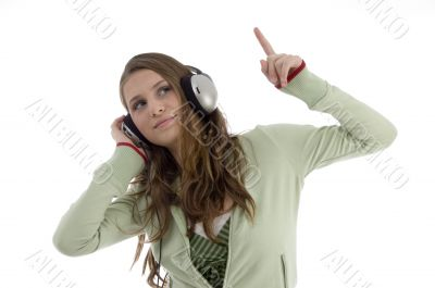 woman in dancing posture while listening music